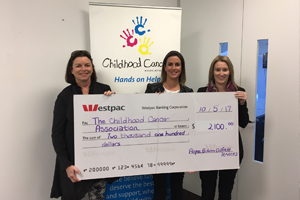 Cath O'Loughlin - Childhood Cancer Association CEO, Anais Medwell - Events and Community Engagement Manager and Anna Boynton - Family Service Manager receive funds from Airpac Bukom.