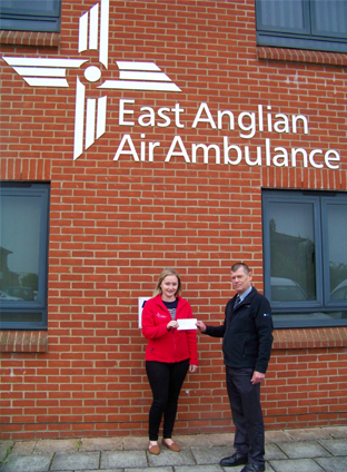Great Yarmouth Base Manager, Malcolm Loades, handing over a cheque to Gemma Mckail at East Anglian Air Ambulance.