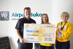 Haydn Davies hands over cheque to Lauren Edwards, Community Fundraiser and Sheena Clarke, a volunteer for the local Marie Curie fundraising group.