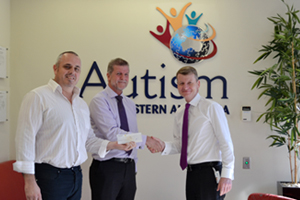 Airpac Bukom Operations Manager, Jon Denham and Director - Australia, Graham Pemberton, hand over a cheque to Autism Association of Western Australia.